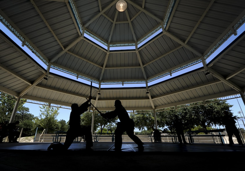 An Airmen with the 25th Intelligence Squadron and Amado Garcia, a Kuk Sool Won instructor, perform a Kuk Sool Won demonstration during the Asian American and Pacific Islander Cultural Day event at Hurlburt Field, Fla., May 25, 2017. Kuk Sool Won is a martial art system that was founded in 1961. The event included a demonstration, free food and a hula demonstration. (U.S. Air Force photo by Airman 1st Class Dennis Spain)