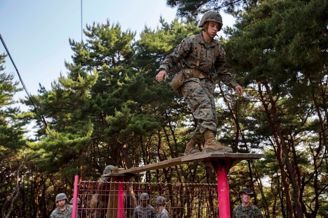 Marines and sailors negotiate a balance beam as part of the Leadership Reaction Course at Camp Mujuk, South Korea, May 29, 2017. Marine Corps photo by Cpl. David A. Diggs