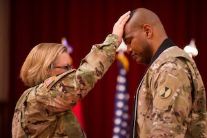 Army Chaplain (Lt. Col.) Khallid Shabazz, right, participates in a ceremony in which he became the 7th Infantry Division chaplain at Joint Base Lewis-McChord, Wash., May 23, 2017. Shabazz is the Army's first Muslim chaplain at the division level. Courtesy photo