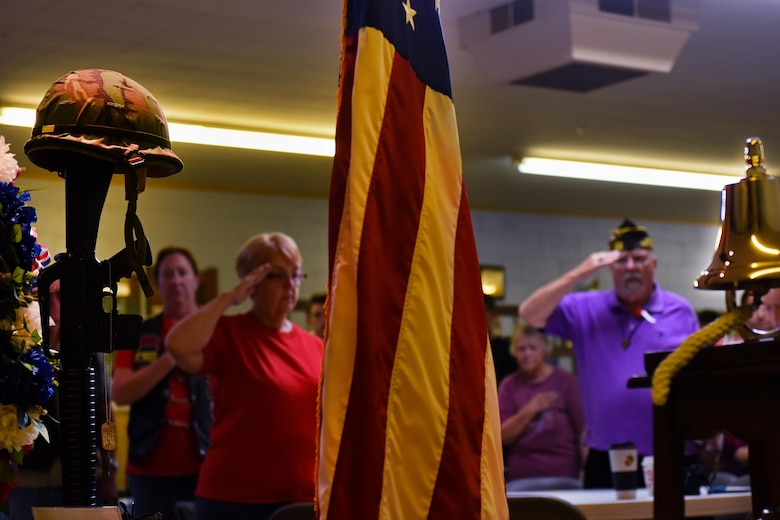 Veterans and volunteers present arms during the playing of taps, May 27, 2017, at the Wayne County Veterans & Patriots Coalition Post 11 in Dudley, North Carolina. In recognition of Memorial Day, the Wayne County Veterans & Patriots Coalition hosted a breakfast and placed flags on veterans' headstones at multiple cemeteries across the county. (U.S. Air Force photo by Senior Airman Ashley Maldonado-Suarez)