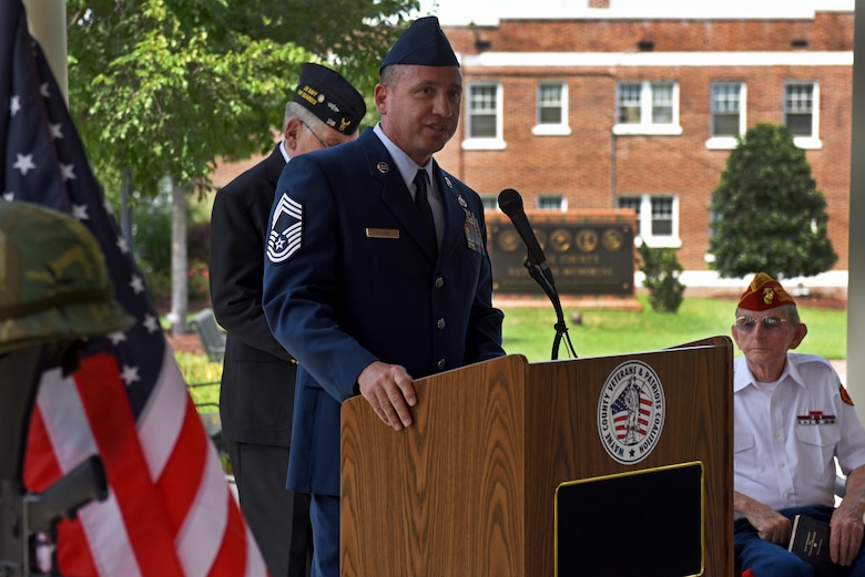Chief Master Sgt. Eugene Elking, acting 4th Fighter Wing command chief, speaks at the Wayne County Veterans Memorial, May 29, 2017, in Goldsboro, North Carolina. In honor of Memorial Day, veterans in Wayne County attended a ceremony and held a moment of silence for the fallen. (U.S. Air Force photo by Senior Airman Ashley Maldonado-Suarez)