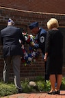 Sylvania Wilkerson (left), the Military Order of the Purple Heart commander, Chief Master Sgt. Eugene Elking, acting 4th Fighter Wing command chief (center), and Brenda Albritton (right), U.S. Air Force Gold Star wife, place a commemorative wreath, May 29, 2017, at the Wayne County Veterans Memorial in Goldsboro, North Carolina. Veterans in Wayne County gathered to hold a moment of silence to honor the fallen. (U.S. Air Force photo by Senior Airman Ashley Maldonado-Suarez)