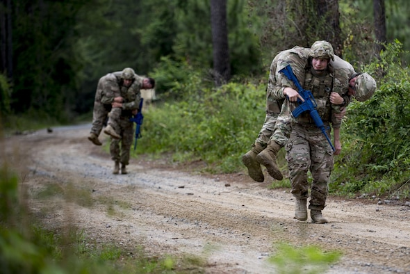 Airman 1st Class Homer Holland, 822d Base Defense Squadron fireteam member, carries an unconscious team member during a simulated explosives and hazardous material scenario, May 24, 2017, at Moody Air Force Base, Ga. The exercise simulated initial responses from first responders who then contacted other appropriate units after assessing the potential threat while also assisting the simulated victims of hazardous materials. (U.S. Air Force photo by Airman 1st Class Daniel Snider)