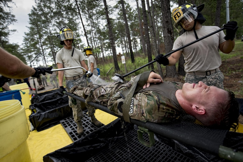Members of the 23d Civil Engineer Squadron fire department conduct decontamination procedures during a simulated explosives and hazardous material scenario, May 25, 2017, at Moody Air Force Base, Ga. The exercise simulated initial responses from first responders who then contacted other appropriate units after assessing the potential threat while also assisting the simulated victims of hazardous materials. (U.S. Air Force photo by Airman 1st Class Daniel Snider)