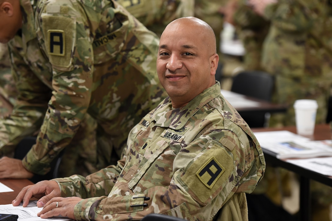 Army Reserve Lt. Col. Augusto Villalazhiguero, Commander, 2nd Battalion, 345th Regiment, Fort Jackson, South Carolina, pauses for a photo during the 85th Support Command's New Command Teams Orientation brief in Arlington Heights, Ill. on May 19-20, 2017. Villalazhiguero said having the opportunity to hear exactly how the unique partnership between the 85th SPT CMD and First Army works from the leadership is incredibly useful.  (U.S. Army photo by Sgt. Aaron Berogan/Released)