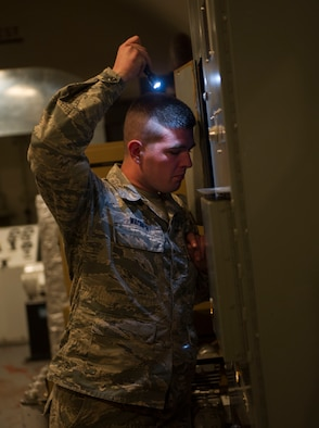 "Senior Airman Kenneth Wagner, 91st Missile Maintenance Squadron facilities maintenance section technician, checks a panel outside of the launch control center at H-01 Missile Alert Facility in the missile complex, N.D., May 24, 2017. Airmen from the 91st MMXS teamed up with Airmen from the 5th Civil Engineer Squadron for ""Blitzkrieg,"" an operation where all the work orders that accrued during the winter months are completed. (U.S. Air Force photo/Senior Airman Apryl Hall)"