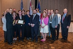DLA Land and Maritime Deputy Commander and Federal Executive Association Chair James McClaugherty (right) presents the Team Innovation award to Land and Maritime's Aircraft Launch and Recovery Equipment team during the May 24 FEA luncheon.