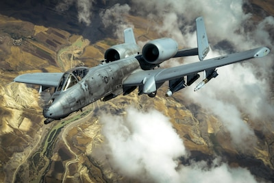 An Air Force A-10 Thunderbolt II flies in an undisclosed location after receiving fuel from a KC-10 Extender while supporting Operation Inherent Resolve, May 31, 2017. The A-10's combat radius and short takeoff and landing capability permit operations in and out of locations near front lines. Air Force photo by Staff Sgt. Michael Battles