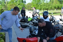 Army Staff Sgt. Joseph Reeves discusses motorcycle safety with Army Staff Sgt. David Meyer before they depart on the safety check ride April 28, 2017, at the Defense Information School. The safety check ride demonstrates the facility's commitment to safety by ensuring riders wear all the proper gear while riding through the Fort Meade community.