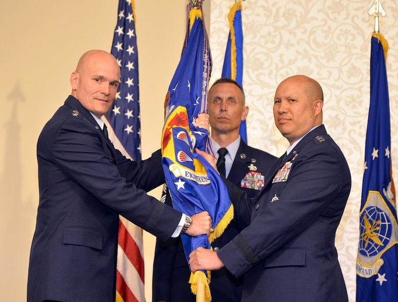 Gen. Carlton D. Everhart II, Air Mobility Command commander, passes the 18th Air Force guidon to Lt. Gen. Giovanni Tuck, the new 18th Air Force commander, during a change of command ceremony at the Scott Event Center, Scott Air Force Base, Illinois, June 1, 2017. Tuck comes to 18th Air Force from U.S. Transportation Command where he served as the Director of Operations and Plans. As 18th AF commander, Tuck is responsible for the command's worldwide operational mission of providing rapid global mobility and sustainment for America's armed forces through airlift, aerial refueling, aeromedical evacuation and contingency response. (U.S. Air Force photo by Master Sgt. Thomas J. Doscher)