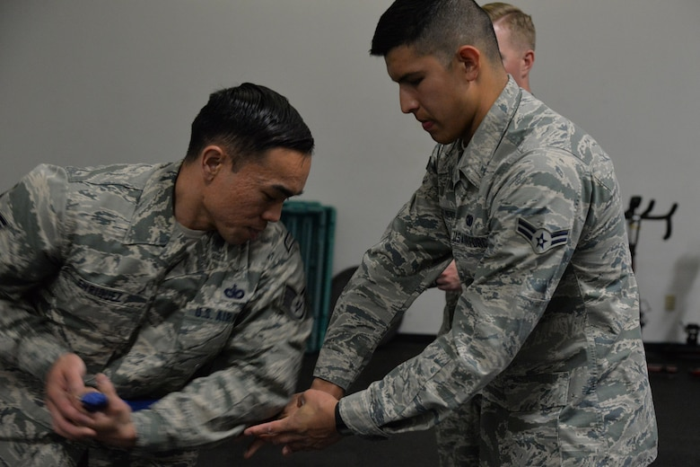 Staff Sgt. Franz Enriquez, 341st Missile Security Forces Squadron defender, and himself a Phoenix Raven, left, and Airman 1st Class Cristian Hernandez Mendoza, 341st MSFS response force leader, practice unarmed self-defense techniques before attending Phoenix Raven training May 25, 2017, at Malmstrom Air Force Base, Mont. The Phoenix Raven program ensures an acceptable level of close quarter security for aircraft transiting airfields where security is unknown or additional security is needed to counter local threats. (U.S. Air Force photo/Airman 1st Class Daniel Brosam)