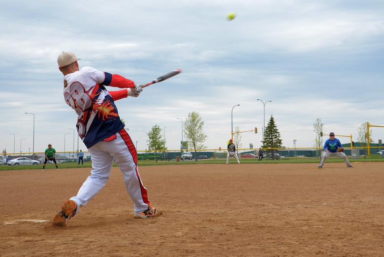 A Grand Forks Airmen bats during the 3rd annual North Dakota military softball tournament at Devils lake N.D., May 25, 2017. Team Minot faced-off against Team Grand Forks and ended with a score of 16-10 in the 3rd annual softball tournament in Devil's Lake, N.D. (U.S. Air Force photo/Airman 1st Class Dillon Audit)