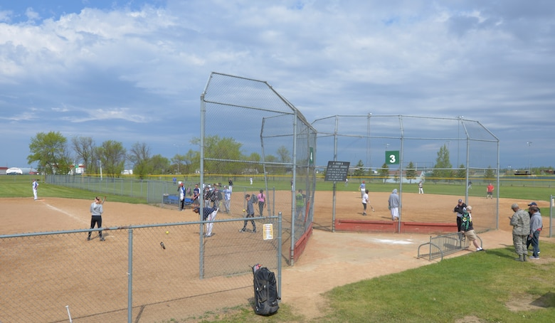 Minot and Grand Forks Air Force Base Airmen play Softball at Roosevelt Park in Devils Lake N.D., May 25, 2017. Before the 3rd annual North Dakota military softball tournament, Minot and Grand Forks Airmen plays a couple of practice games in order to warm up for the tournament. (U.S. Air Force photo/Airman 1st Class Dillon Audit)