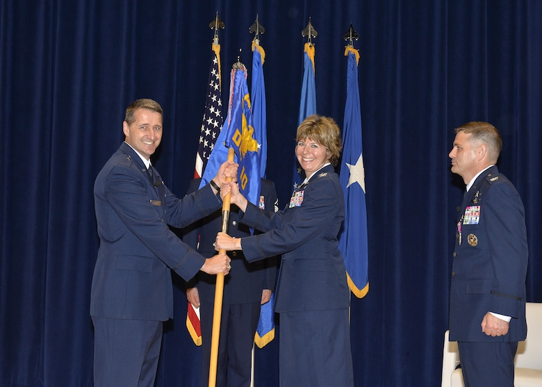 Col. Kerry R. Lovely (center), the incoming I.G. Brown Training and Education Center Commander, takes the detachment guidon from Brig. Gen. Steven S. Nordhaus, Air National Guard Readiness Center commander and ceremony officiator, during the change of command ceremony at McGhee Tyson Air National Guard Base, Tenn., June 1, 2017. During the ceremony Col. Kevin M. Donovan (right) relinquished command of TEC to Colonel Lovely, a former TEC Academy of Military Science graduate. (U.S. Air National Guard photo by Master Sgt. Jerry Harlan)