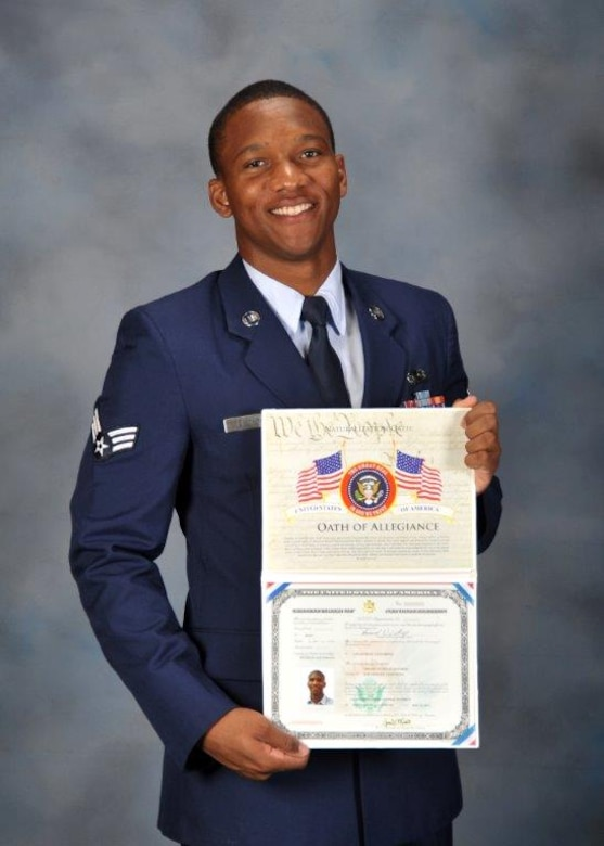 Senior Airman Gerard Listhrop from the Space and Missile Systems Center Financial Management office holds his citizenship certificate after he was sworn in as a U.S. citizen. U.S. Air Force photo.