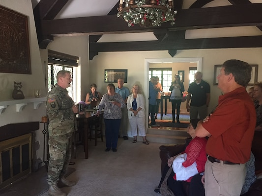 U.S. Army Engineer Research and Development Center's Commander Col. Bryan Green shown on left, and his wife Yana, not shown in photo, host a Spouses Coffee at their on-campus residence, the Vogel House. Green shares the history behind the house and the property, which is located within the City of Vicksburg, Mississippi.