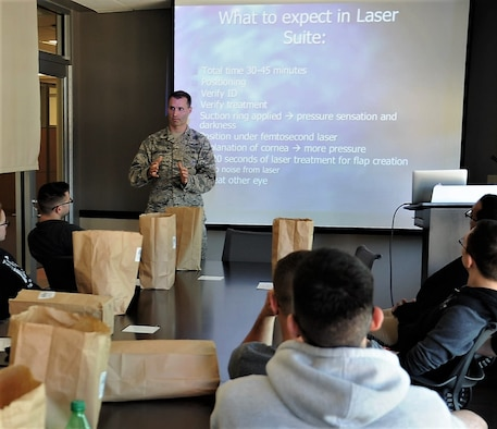 Dr. Williams Gensheimer (standing), 779th Medical Group's Warfighter Eye Center chief, conducts a briefing for patients scheduled to undergo corneal refractive surgery May 15, 2017 at Joint Base Andrews, Md. Gensheiemer, one of the Center's ophthalmologists, dsicussed the risks about eye surgery, how he will conduct the procedure step-by-step and what the patients can expect after the CRS is complete. (U.S. Air Force photo by Joe Yanik)