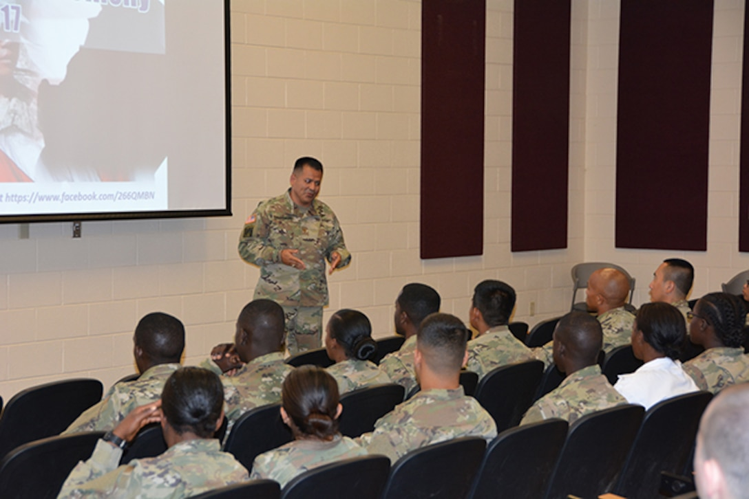 Defense Logistics Agency Aviation Army Maj.  Alex Shimabukuro shares his naturalization story with 28 service members from 18 countries May 30, 2017 as they joined the latest ranks of U.S. citizens during a naturalization ceremony held at Fort Lee, Virginia's Soldier Support Center.