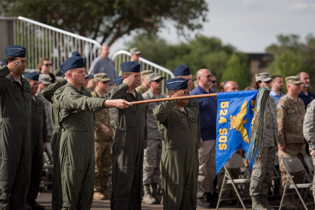 Members of the 524th Special Operations Squadron render salutes during an end of mission ceremony at the 27th Special Operations Wing building May 31, 2017 at Cannon Air Force Base, N.M. The 524th is relocating to Duke Field, Florida, where the command will change hands from the 27th SOW to the 492nd SOW. The ceremony is also historical as the 524th is the last remaining squadron on the base that has original ties to the 27th SOW. (U.S. Air Force photo by Staff Sgt. Michael Washburn/Released)