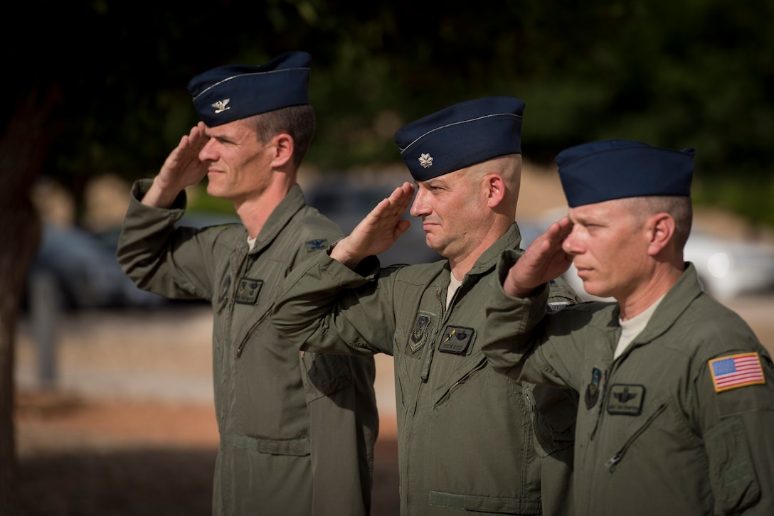 (Left) Col. Benjamin Maitre, 524th Special Operations Wing commander, (middle) Lt. Col. Derick Steed, 524th Special Operations Squadron commander, and Chief Master Sgt. Erik Thompson, 27 SOW command chief, salute during retreat at the 524 SOS end of mission ceremony on Cannon Air Force Base, N.M., May 31, 2017. The 524th is relocating to Duke Field, Florida, where the command will change hands from the 27th SOW to the 492nd SOW. The squadron has ties back to WWII, before it received its numerical designation of 524. (U.S. Air Force photo by Staff Sgt. Michael Washburn/Released)