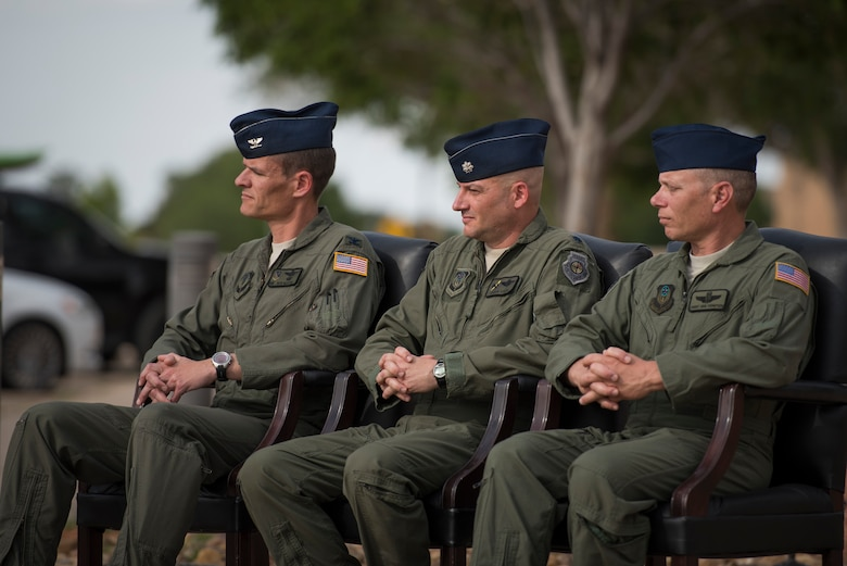 (Left) Col. Benjamin Maitre, 524th Special Operations Wing commander, (middle) Lt. Col. Derick Steed, 524th Special Operations Squadron commander, and Chief Master Sgt. Erik Thompson, 27 SOW command chief, sit during a 524 SOS end of mission ceremony at Cannon Air Force Base, N.M., May 31, 2017. The 524th is relocating to Duke Field, Florida, where the command will change hands from the 27th SOW to the 492nd SOW. The squadron has ties back to WWII, before it received its numerical designation of 524. (U.S. Air Force photo by Staff Sgt. Michael Washburn/Released)
