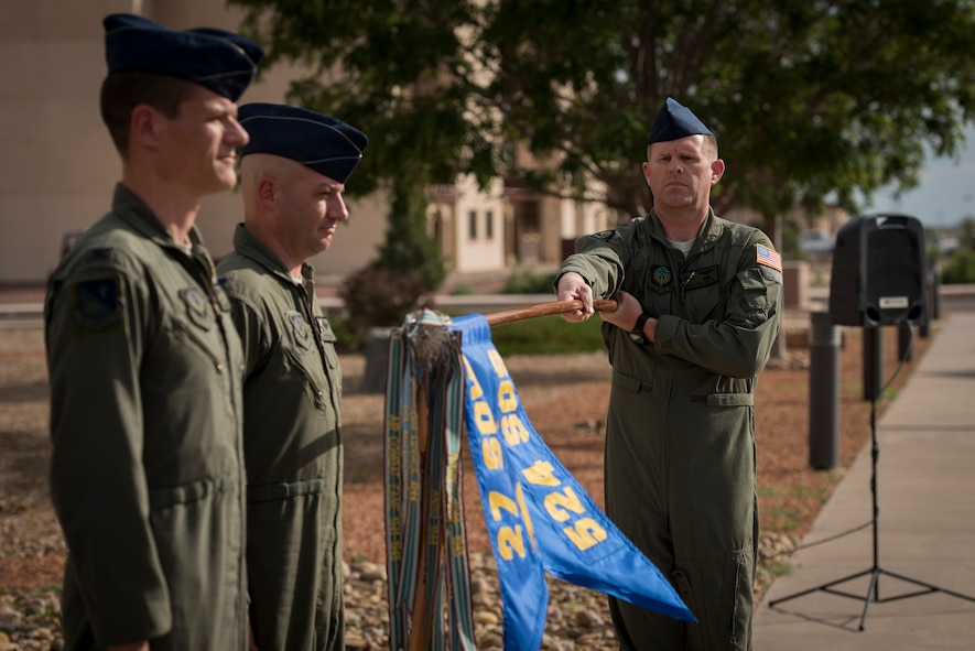 Master Sgt. Chad Beach, 524th Special Operations Squadron first sergeant, holds the guidon before it is ceremoniously covered during the 524 SOS end of mission ceremony at Cannon Air Force Base, N.M., May 31, 2017. The 524th is relocating to Duke Field, Florida, where the command will change hands from the 27th SOW to the 492nd SOW. (U.S. Air Force photo by Staff Sgt. Michael Washburn/Released)