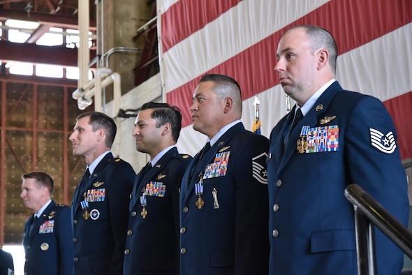 Commander of the 19th Air Force, Maj. Gen Patrick J. Doherty, (far left) presented four instructors from the 58th Special Operations Wing with Distinguished Flying Cross medals during a ceremony at Kirtland Air Force Base May 23. (Left to right) Maj. Robert Meyersohn, Maj. Arjun Rau, TSgt. David Shea and Tech. Sgt. Kenneth Zupow received the medals for their harrowing feats of bravery during separate missions in downrange environments.