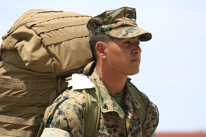 A rifleman with Lima Company, Battalion Landing Team 3rd Battalion, 5th Marines, 31st Marine Expeditionary Unit, carries a pack after arriving at Camp Hansen, Okinawa, Japan, May 11, 2017. BLT 3/5 replaced BLT 2/5 as the Ground Combat Element of the 31st MEU. As the Marine Corps' only continuously forward-deployed unit, the 31st MEU air-ground-logistics team provides a flexible force, ready to perform a wide range of military operations, from limited combat to humanitarian assistance operations, throughout the Indo-Asia-Pacific region. (U.S. Marine Corps photo by Lance Cpl. Stormy Mendez)
