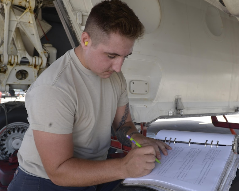 An Airman with the 36 Expeditionary Aircraft Maintenance Squadron annotates in an aircraft maintenance forms as he and his team load munitions into a B-1B Lancer May 31, 2017, at Andersen Air Force Base Guam. The team is deployed here from Dyess AFB, Texas, in support of Pacific Command's Continuious Bomber Presence mission. (U.S. Air Force photo by Senior Airman Cierra Presentado/Released)