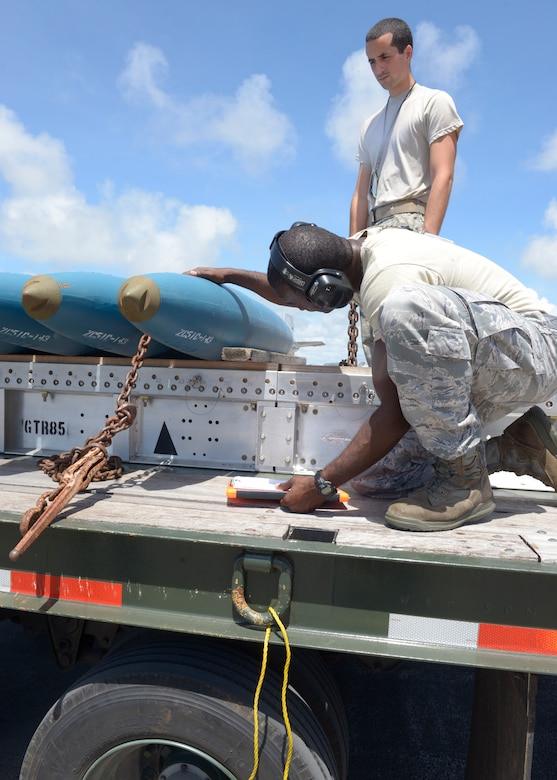 Tech. Sgt. Tyrone Garner, 36th Expeditionary Maintenance Squadron weapons expediter, checks out a Bomb Disposal Unit 50, before instructing his team to load them onto a B-1 Lancer May, 30, 2017 at Andersen Air Force Base, Guam. Depending on the mission of the Lancer, the crew may load Joint Direct Attack Munitions, Joint Air-to-Surface Standoff Missiles or when practicing, Bomb Disposal Units 50 and 56. (U.S. Air Force photo by Senior Airman Cierra Presentado/Released)