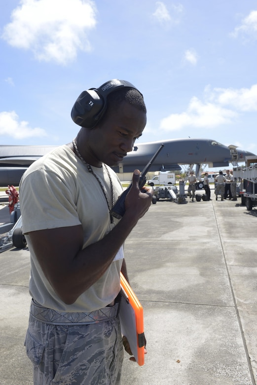Tech. Sgt. Tyrone Garner, 36th Expeditionary Aircraft Maintenance Squadron weapons expediter, gives commands via radio to his weapons loading team May, 30, 2017, at Andersen Air Force Base, Guam. Garner and his team are deployed here from Dyess AFB, TX, in support of Pacific Command's Continuous Bomber Presence mission. (U.S. Air Force Photo by Senior Airman Cierra Presentado/Released)