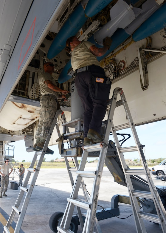 Airmen from the 36th Expeditionary Aircraft Maintenance Squadron load Bomb Disposal Unit 50 into a B-1 Lancer May 30, 2017, at Andersen Air Force Base, Guam. The team, deployed here from Dyess AFB, TX, loads munitions such as Joint Direct Attack Munitions, Joint Air-to-Surface Standoff Missiles or when practicing, BDU-50 and 56's depending on what the mission requires. (U.S. Air Force photo by Senior Airman Cierra Presentado/Released)