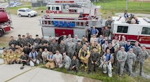 U.S. Air Force firefighters from the Kunsan Air Base 8th Civil Engineer Squadron, Osan Air Base 51st Civil Engineer Squadron, and Republic of Korea Air Force firefighters take a group photograph during a combined fire training on Kunsan Air Base, Republic of Korea, May 23, 2017. U.S. and ROKAF firefighters spent the day training together to help bridge communication gaps and improve their efficiency in responding to real-world scenarios. (U.S. Air Force photo by Senior Airman Colville McFee/Released)