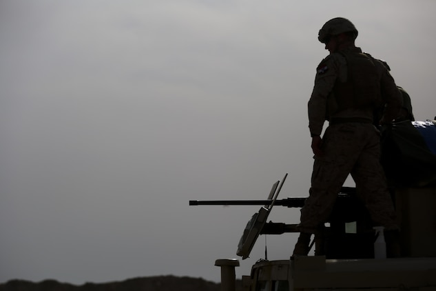U.S. Marine Corps Capt. Zachary Weidner, the Iraqi Security Force Development Officer of Task Force Al-Taqaddum, deployed in support of Combined Joint Task Force – Operation Inherent Resolve, watches as an Iraqi soldier with 1st Company, 2nd Battalion, 40th Brigade, 10th Iraqi Army Division, fire a .50-caliber machine gun while training in Iraq, April 12, 2017. This training provided the Iraqi soldiers an opportunity to hone their skills with large weapons systems. This training is part of the overall CJTF-OIR building partner capacity mission by training and improving the capability of partnered forces fighting ISIS. CJTF-OIR is the global Coalition to defeat ISIS in Iraq and Syria. (U.S. Marine Corps photo by Cpl. Shellie Hall)
