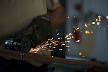 U.S. Air Force Staff Sgt. Ronald Bender, 39th Maintenance Squadron metals technology craftsman, cuts a piece of metal May 30, 2017, at Incirlik Air Base, Turkey. The metals technology shop is capable of repairing and in some cases, creating parts that are no longer in production. (U.S. Air Force photo by Airman 1st Class Devin M. Rumbaugh)