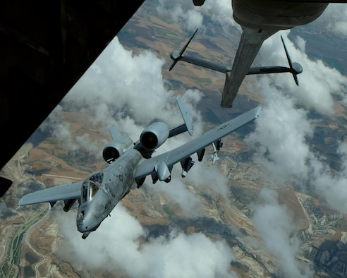 An A-10 Thunderbolt II departs after receiving fuel from a 908th Expeditionary Air Refueling Squadron KC-10 Extender May 31, 2017, over an undisclosed location in southwest Asia. The Thunderbolt II can employ a wide variety of conventional munitions and the GAU-8/A 30mm cannon, capable of firing 3,900 rounds per minute to defeat a wide variety of targets including tanks. (U.S. Air Force photo by Senior Airman Preston Webb)
