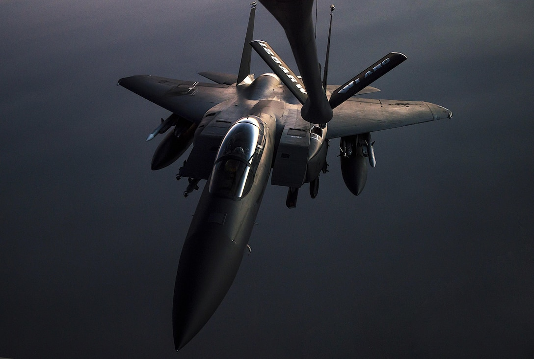 An F-15E Strike Eagle arrives to receive fuel from a 340th Expeditionary Air Refueling Squadron KC-135 Stratotanker during a flight in support of Operation Inherent Resolve May 23, 2017. The KC-135 provides aerial refueling capabilities as it supports U.S. and coalition forces working to liberate territory and people under the control of Islamic State of Iraq and Syria. (U.S. Air Force photo/Staff Sgt. Trevor T. McBride)