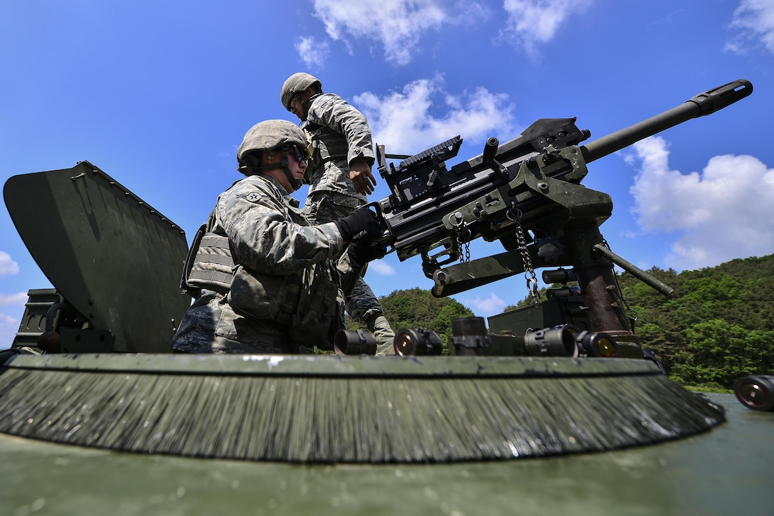 Airman Destri Snow, a 51st Security Forces Squadron defender, fires an MK-19 grenade launcher during  weapons qualification training at Camp Rodriguez, South Korea, May 24, 2017. The training ensures defenders are vigilant and mission ready. (U.S. Air Force photo/Airman 1st Class Gwendalyn Smith)