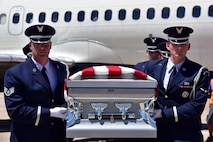An Air Force honor guard team transfers the remains of Staff Sgt. Robert Dale Van Fossen, of Greenbrier, Ark., May 25, 2017, at the Bill and Hillary Clinton National Airport. Van Fossen died Nov. 22, 1952, when a Douglas C-124A-DL Globemaster II  went down. The aircraft took off from McChord Air Base in Tacoma, Wash., headed for Elmendorf Air Force Base near Anchorage, Ala., with a crew of 11. Van Fossen was one of 41 passengers aboard the aircraft. Prior to enlisting in the Air Force in 1949, Van Fossen served in the Arkansas Army National Guard from 1947 through 1949. (U.S. Air Force photo/Staff Sgt. Jeremy McGuffin)