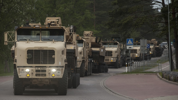 VENTSPILS, Latvia- NATO nations participate in convoy operations alongside Marines while escorted by Latvian Movement and Control officers during exercise Saber Strike 17 in Ventspils, Latvia, May 28, 2017. Exercise Saber Strike 17 is an annual combined-joint exercise conducted at various locations throughout the Baltic region and Poland. The combined training prepares allies and partners to respond more to regional crises and meet their own security needs by improving the security of borders and countering threats.
