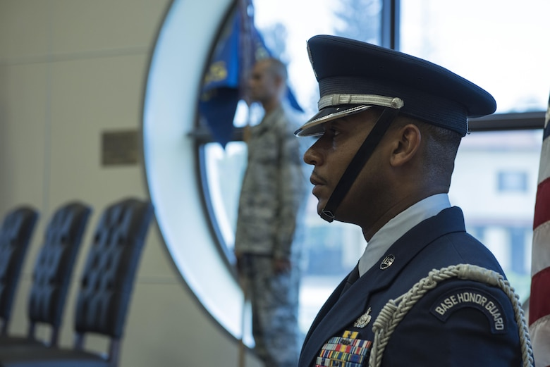 A U.S. Air Force Airman  assigned to the Incirlik Air Base Honor Guard prepares to present the colors during a change of command ceremony, June 1, 2017, at Incirlik Air Base , Turkey. Lt. Col. Robert Grant, 39th Operations Support Squadron outgoing commander, relinquished command to Lt. Col. Richard Swengros, 39th OSS incoming commander. (U.S. Air Force photo by Airman 1st Class Kristan Campbell)
