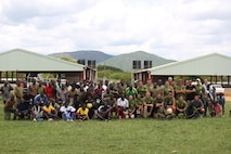 U.S. Marines with Special Purpose Marine Air-Ground Task Force-Crisis Response-Africa and members of Uganda People's Defence Force pose for a photograph after competing in a final soccer match between UPDF soldiers, and the instructors of SPMAGTF-CR-AF. The UPDF soldiers claimed the final victory with a score of 3-2. (U.S. Marine Corps photo by 1st Lt. Johnny Henderson.)