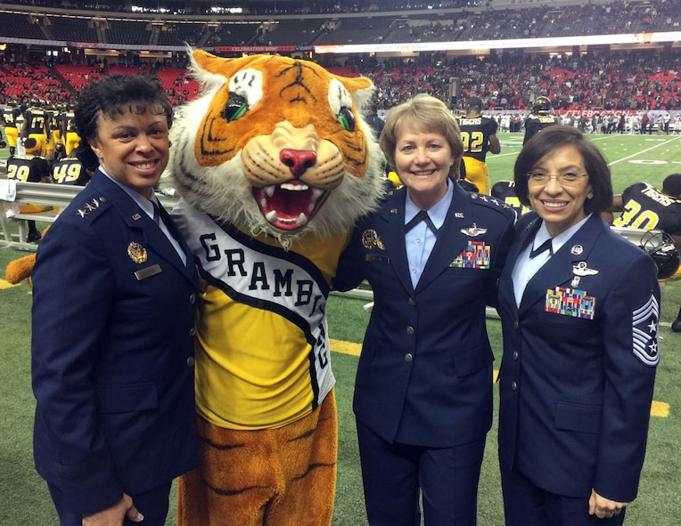 Eddie the Tiger, aka Senior Airman Quincy Wheaton, poses with (left to right) Lt. Gen. Stayce Harris, assistant vice chief of staff and director of the Air Staff, Headquarters Air Force, Washington, D.C.; Lt. Gen, Maryanne Miller, Air Force Reserve Command commander; and Chief Master Sgt. Ericka Kelly, AFRC command chief. (U.S. Air Force photo by Master Sgt. Chance Babin)