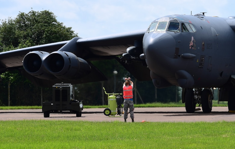 U.S. Air Force Senior Airman Calvin Kunkel, 2nd Aircraft Maintenance Squadron assistant dedicated crew chief, marshals a B-52H Stratofortress from Barksdale Air Force Base, La., at RAF Fairford, U.K., June 1, 2017. Approximately 800 Striker Airmen from Air Force Global Strike Command are participating in joint and combined exercises in the European theatre with 14 allied and partner nations enhancing the Air Force's interoperability and resiliency with allied nations. (U.S. Air Force photo by Airman 1st Class Randahl J. Jenson)