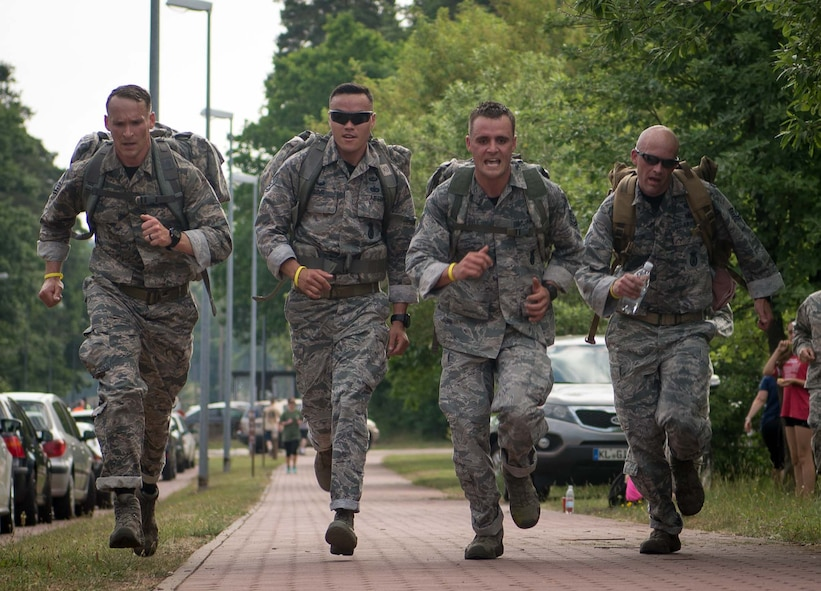 The winners of the Second Annual Chief Master Sgt. of the Air Force Paul Airey Memorial 10K ruck, charge for the finish line on Ramstein Air Base, June 2, 2017. Teams from various squadrons in the Kaiserslautern Military Community area took on the 10K ruck march challenge. Participants were allowed to walk or run but they had to be in uniform and carry 25lb rucks, or backpacks, from start to finish. (U.S. Air Force photo by Airman 1st Class Elizabeth Baker)