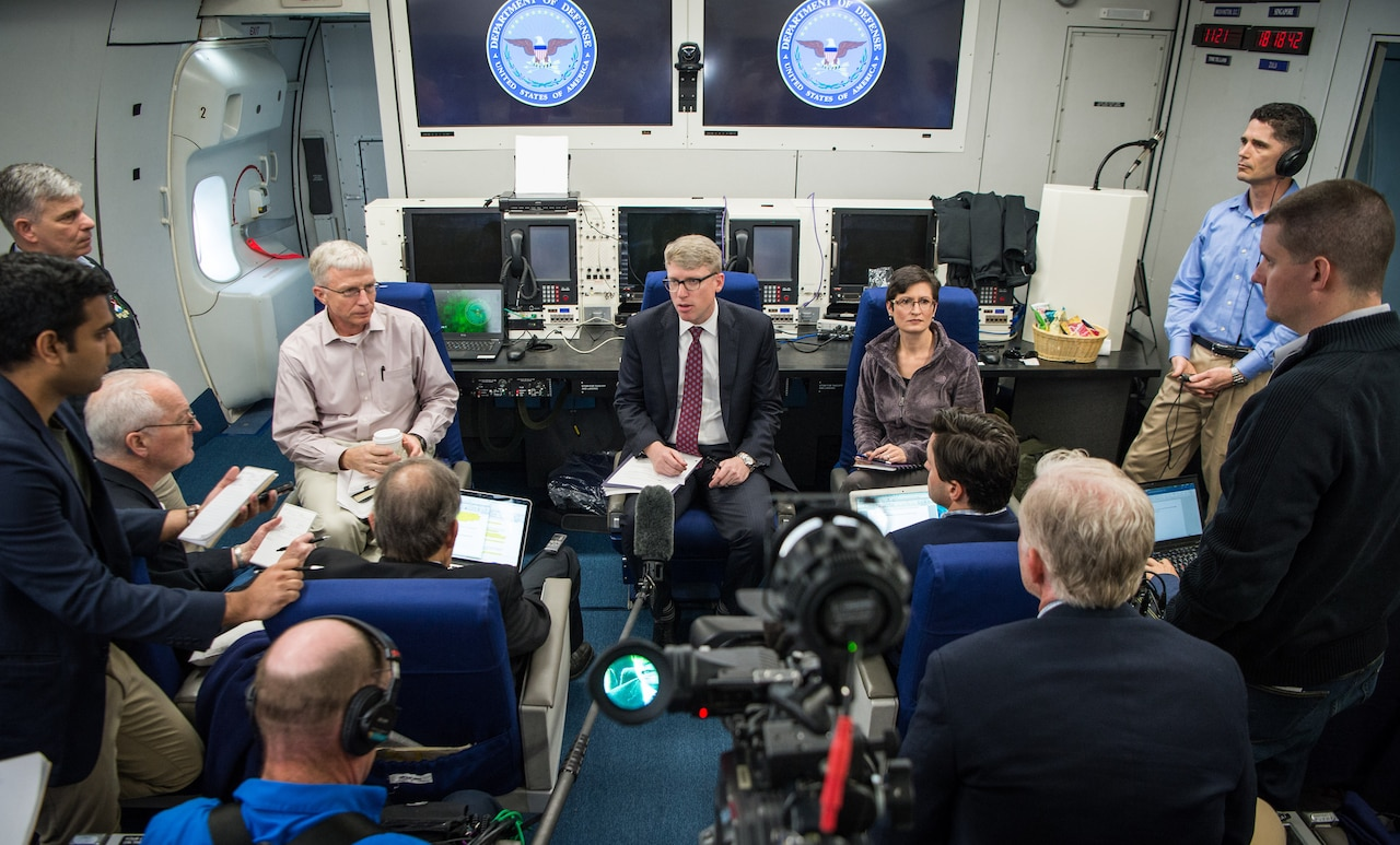 David F. Helvey, performing the duties of the assistant secretary of defense for Asian and Pacific security affairs, briefs reporters on Defense Secretary Jim Mattis' overseas trip while en route to Singapore aboard a military aircraft, June 1, 2017. DoD photo by Air Force Staff Sgt. Jette Carr