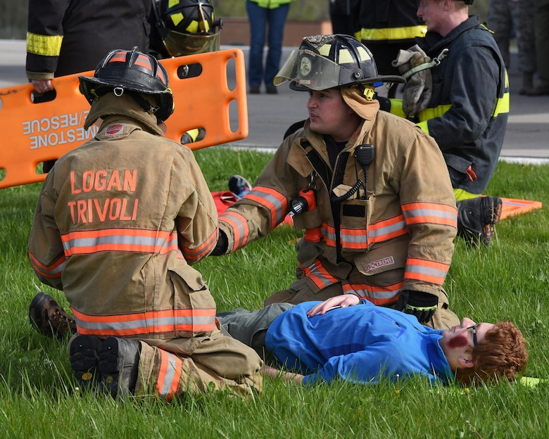 Firefighters from Logan-Trivoli Fire Protection District evaluate the condition of Joshua Palinkas, a senior patrol leader of Boy Scout Troop 88, who is playing the role of a victim of a simulated aircraft crash at the General Wayne A. Downing Peoria International Airport in Peoria, Ill. April 22, 2017.  Thirty-eight agencies and more than 200 exercise participants took part in the full-scale mass casualty exercise. (U.S. Air National Guard photo by Master Sgt. Todd Pendleton)