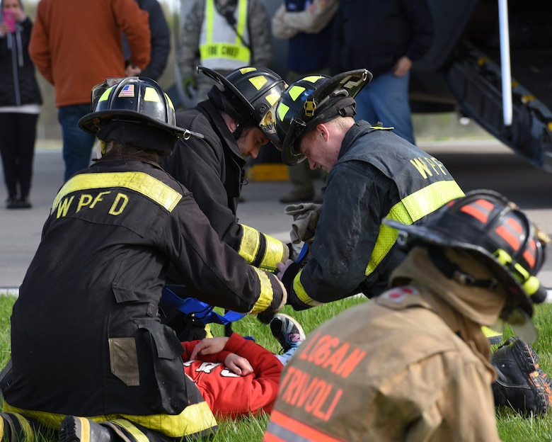Firefighters from Logan-Trivoli Fire Protection District and West Peoria Fire Protection District evaluate the conditions of victims of a simulated aircraft crash at the General Wayne A. Downing Peoria International Airport in Peoria, Ill. April 22, 2017.  Thirty-eight agencies and more than 200 exercise participants took part in the full-scale mass casualty exercise. (U.S. Air National Guard photo by Master Sgt. Todd Pendleton)