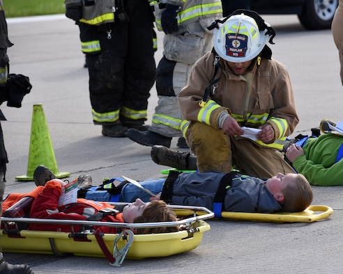 Pastor Ethan Carnes, a firefighter and chaplain with the Timber-Hollis Fire Protection District evaluates the condition of two Boy Scouts who are playing the roles of victims of an aircraft crash at the General Wayne A. Downing Peoria International Airport in Peoria, Ill. April 22, 2017. Thirty-eight agencies and more than 200 exercise participants took part in the full-scale mass casualty exercise. (U.S. Air National Guard photo by Master Sgt. Todd Pendleton)