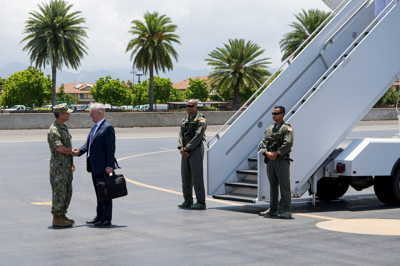 Defense Secretary Jim Mattis is greeted by Navy Adm. Harry B. Harris Jr., commander of U.S. Pacific Command, upon his arrival at Joint Base Pearl Harbor-Hickam, Hawaii, on the stop of an overseas trip, May 31, 2017. DoD photo by Air Force Staff Sgt. Jette Carr